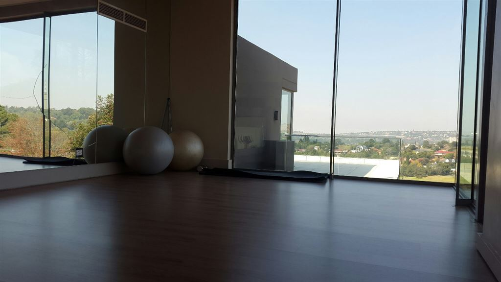 Gym with stretching / yoga area with great views over the golf course and under floor heating