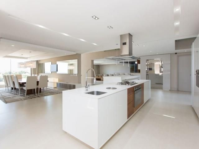 Kitchen island leading to formal dining room