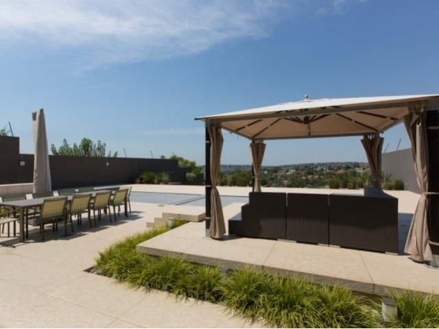 Pool terrace with covered gazebo looking over magnificent views