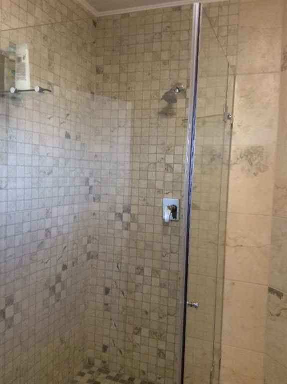 The showers are glass framed, fully tiled to ceilings