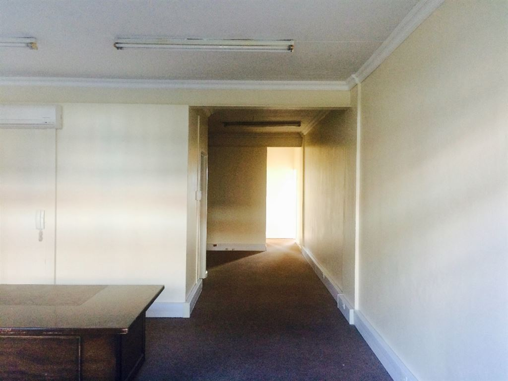 Reception leading to the open plan area and meeting rooms at the back