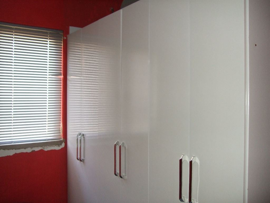 All white cupboards in bedroom