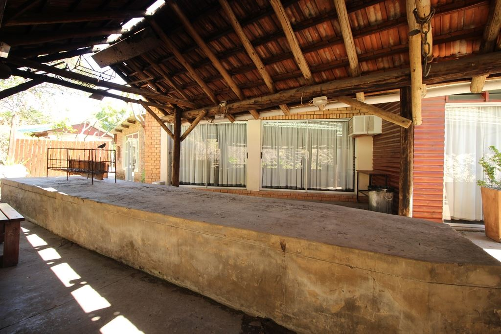 Covered braai area in the courtyard linking the dining hall to the pool area. The small conference room in the back ground