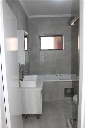 fully tiled bathrooms for easy cleaning