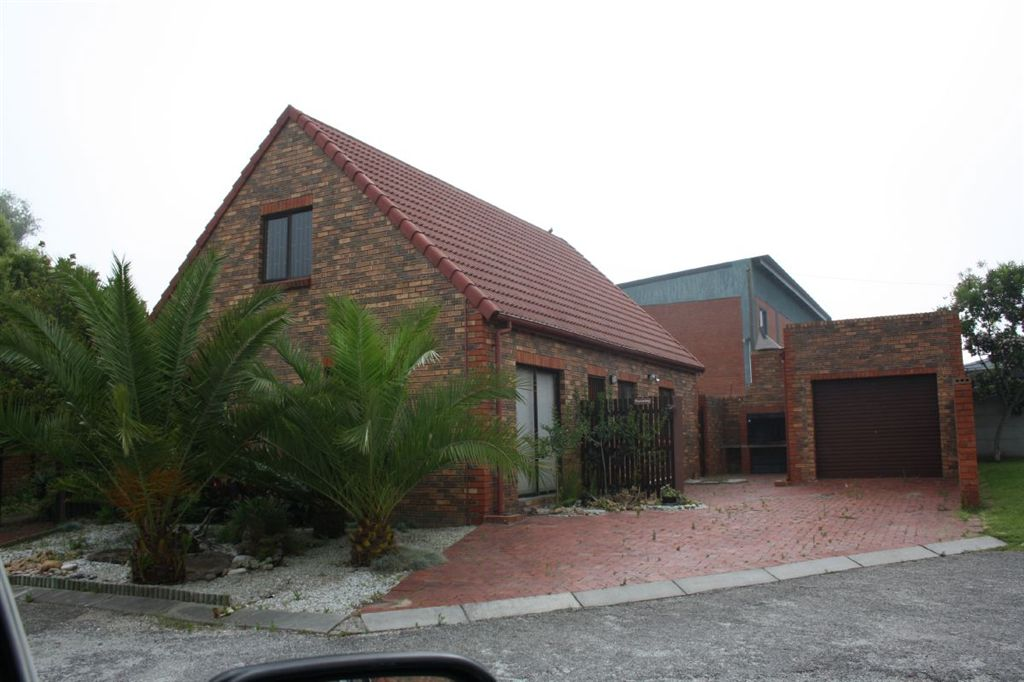 Double storey, single garage with braai area