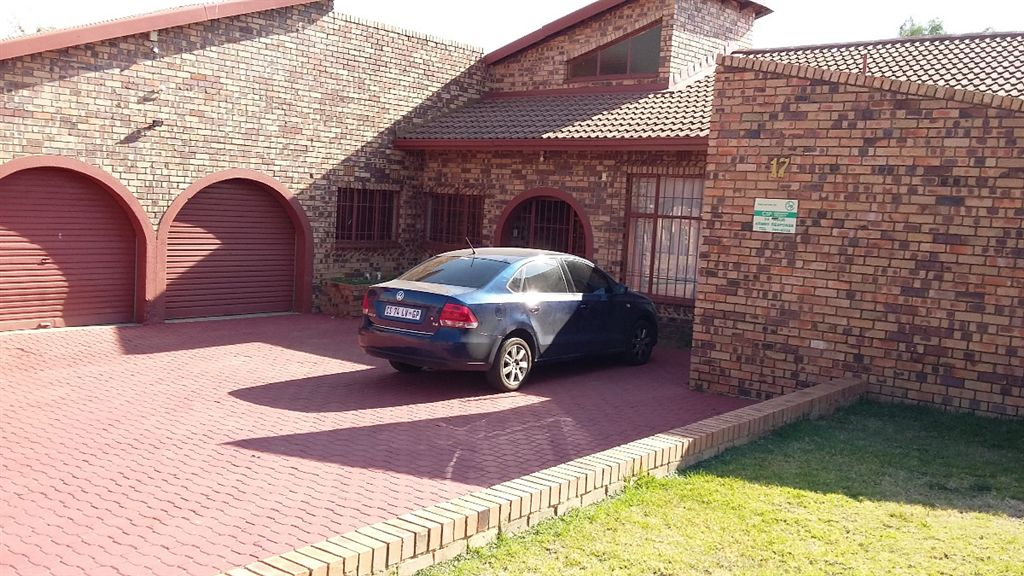 Lovely face brick home in security controlled area.