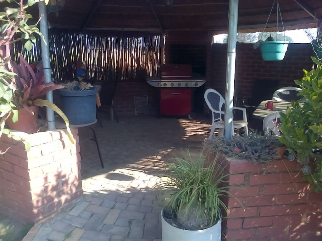 This is a combination braai and entertainment area. It is covered and paved.  Nice for a family braai.