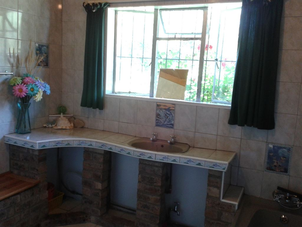 Family bathroom with bath and shower. Separate toilet and en suite off main bedroom.
