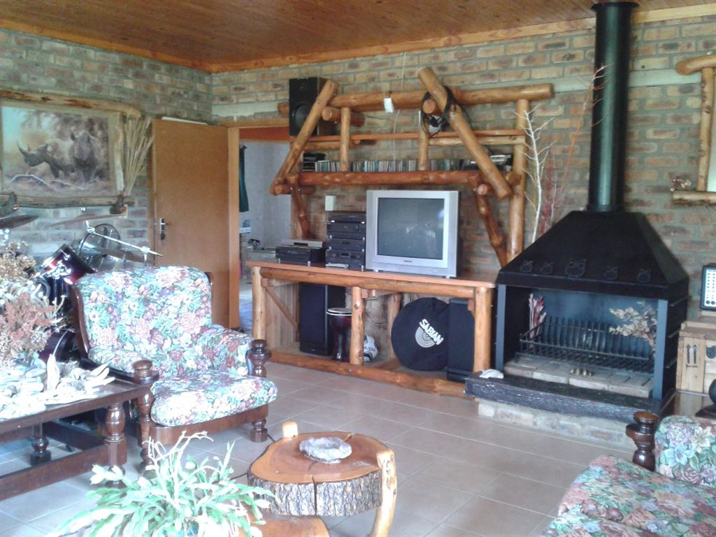 Main lounge with fireplace and pub area, opens onto garden