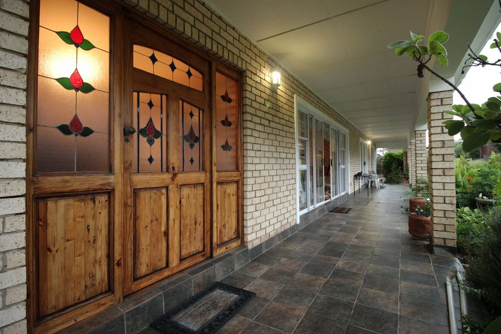 Beautiful stained glass front door and covered patio serving the two bedrooms