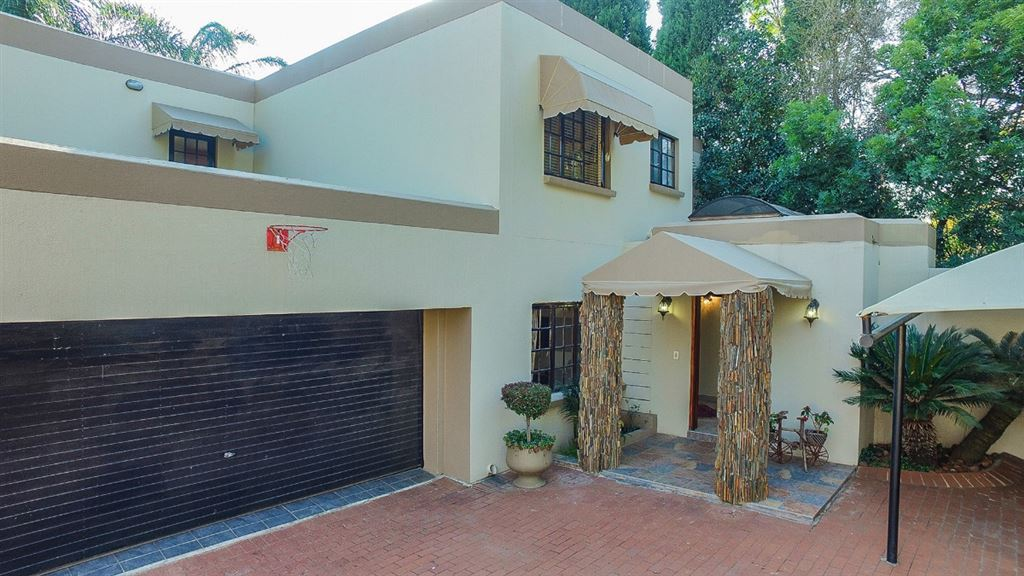 Entrance to the home Double garaging and carports Ample visitors parking Balcony above the garage