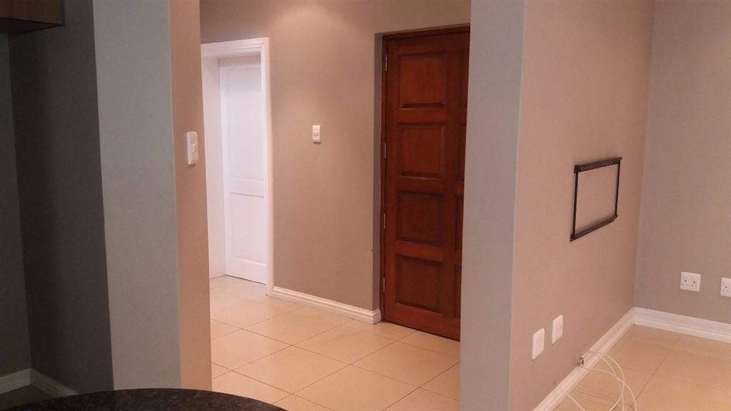Short passage at front door leading to garage and stairway to bedrooms upstairs