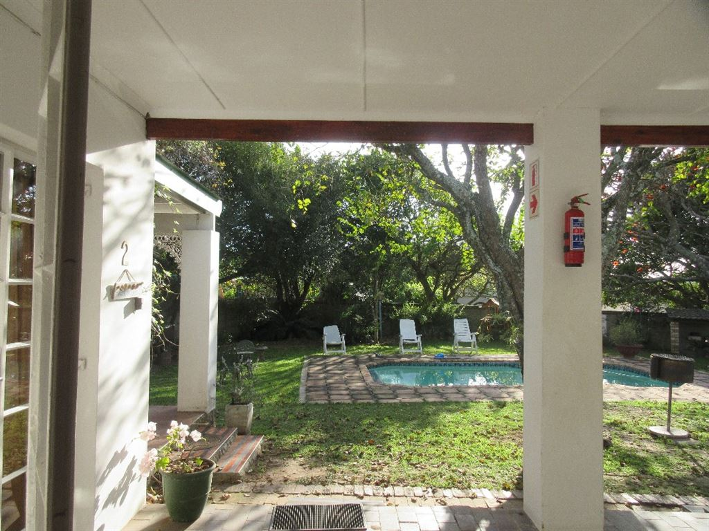 Each cottage has it's own private patio overlooking the well-established garden and the tranquil swimming pool