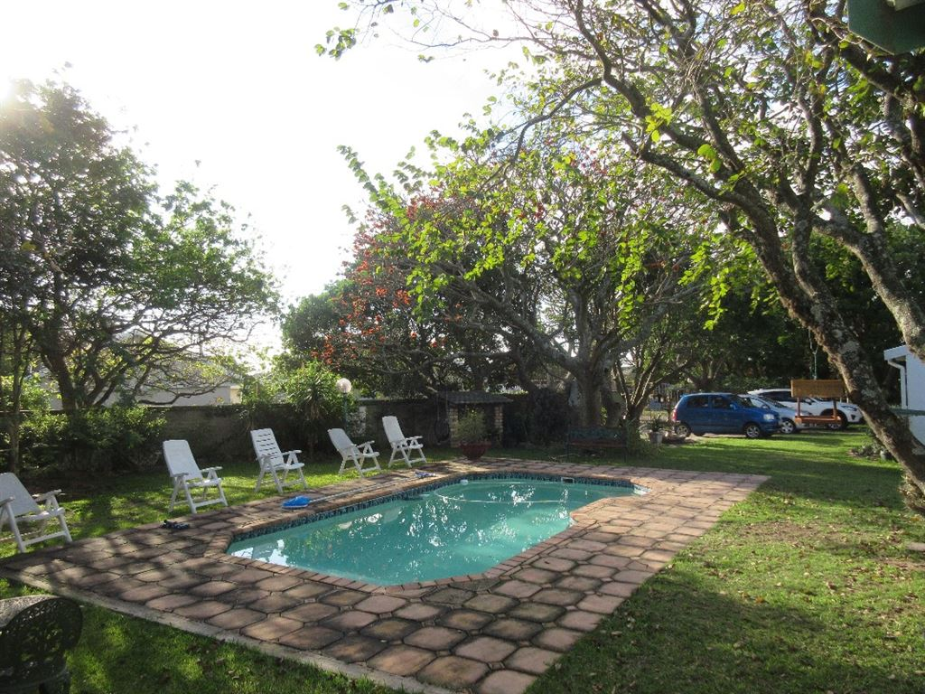 Large, inviting swimming pool leading off from the cottages private patios