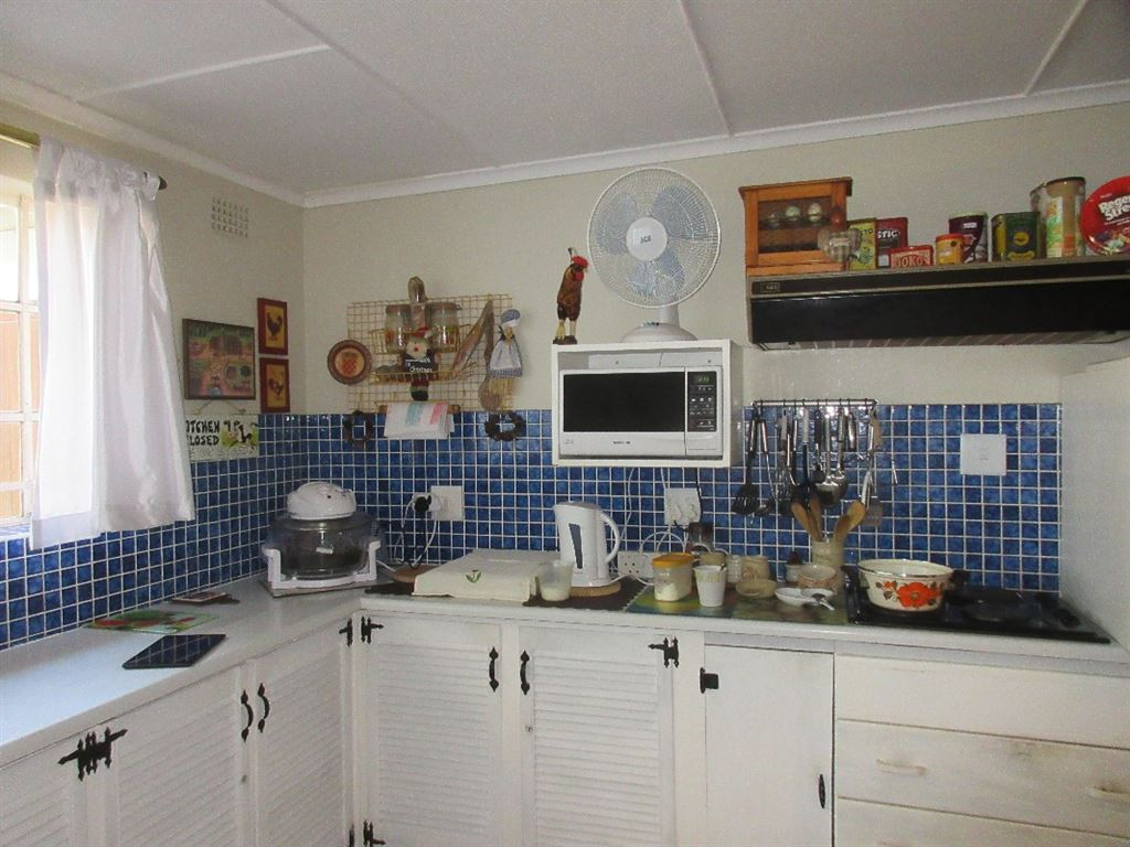 Main dwelling kitchen with plenty of built-in cupboards and working surface area for food preparation. Separate laundry room leads off the kitchen and can also be used as a garage