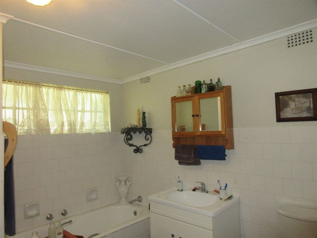 Main dwelling en-suite full bathroom with bath, shower, basin and toilet