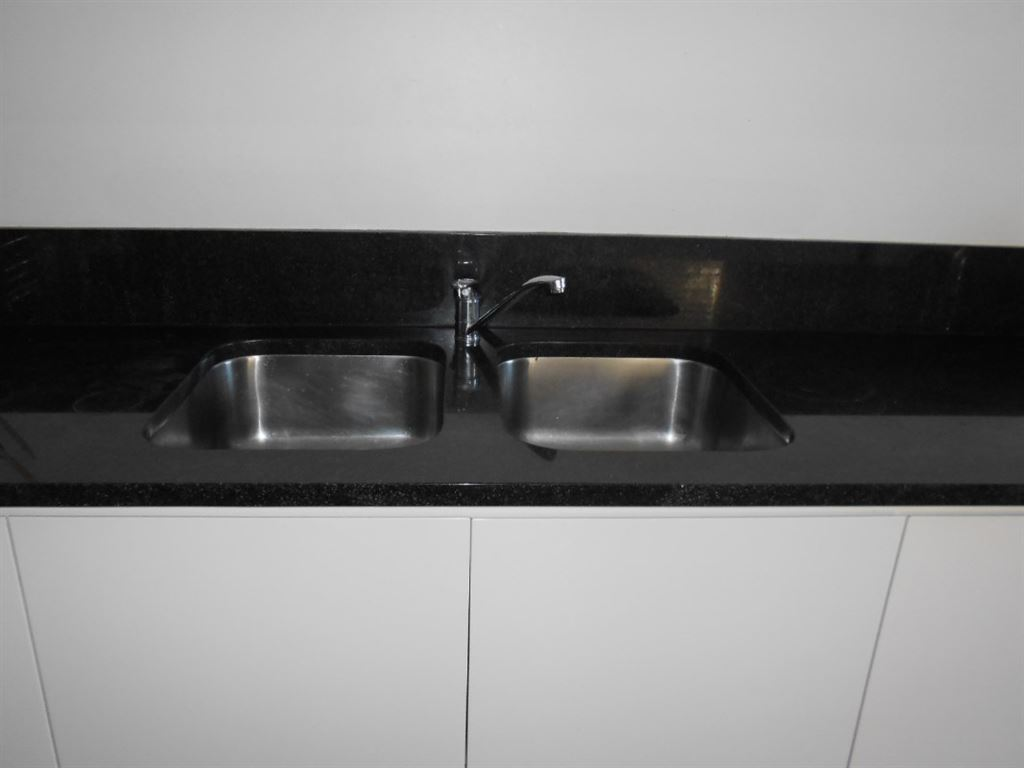 Separate scullery with granite tops.