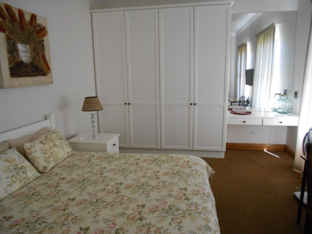 Bedroom with cupboards.