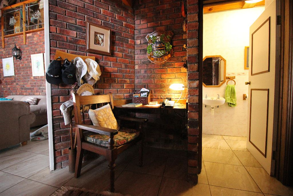 Study nook and guest toilet near the front door of the lodge