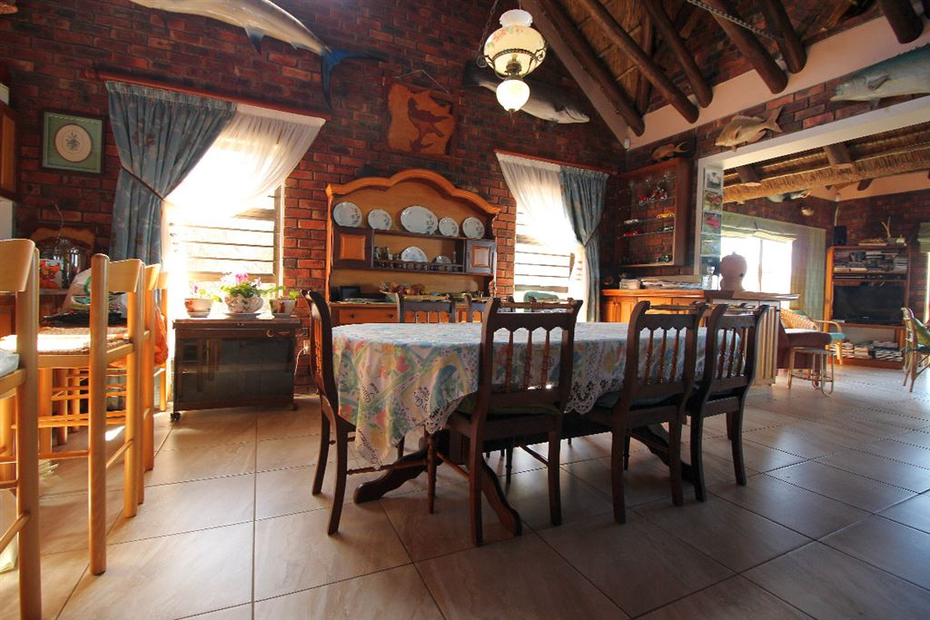 Dining area of the lodge with the entertainment room on the right