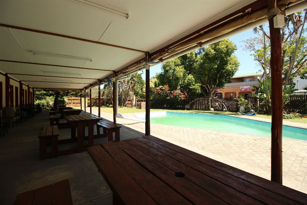 Covered area next to the pool has drop-down blinds and can be divided into 4 separate areas.
