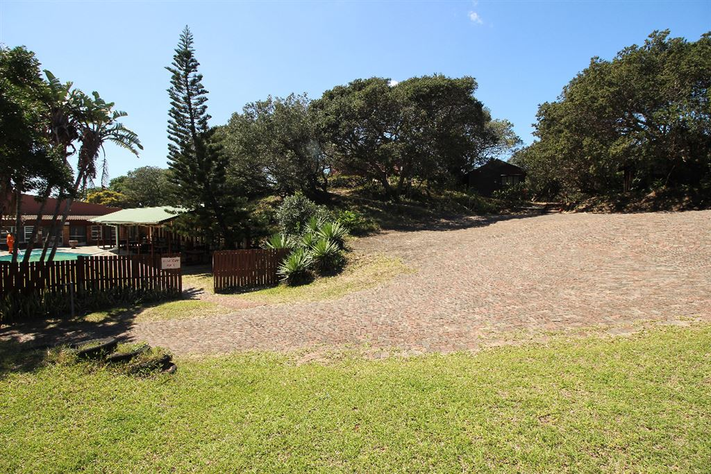 Open grounds and parking area leading to the timber frame chalets