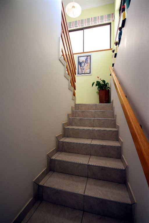 Tiled stairway to kitchen and living area