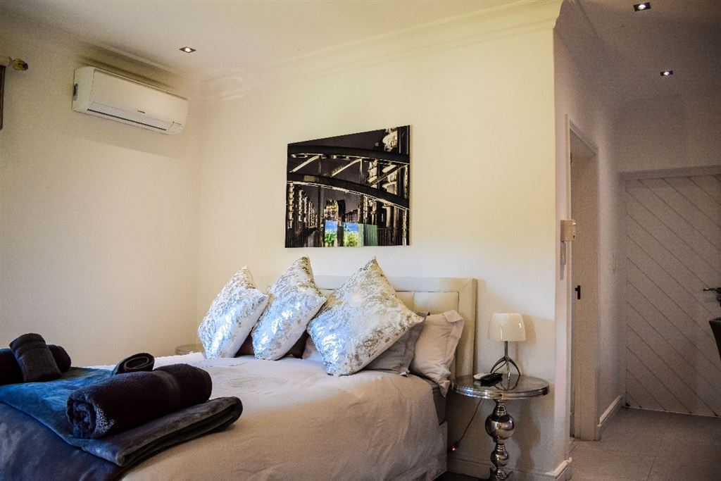 Downstairs guest bedroom with en-suite bathroom and separate entrance.