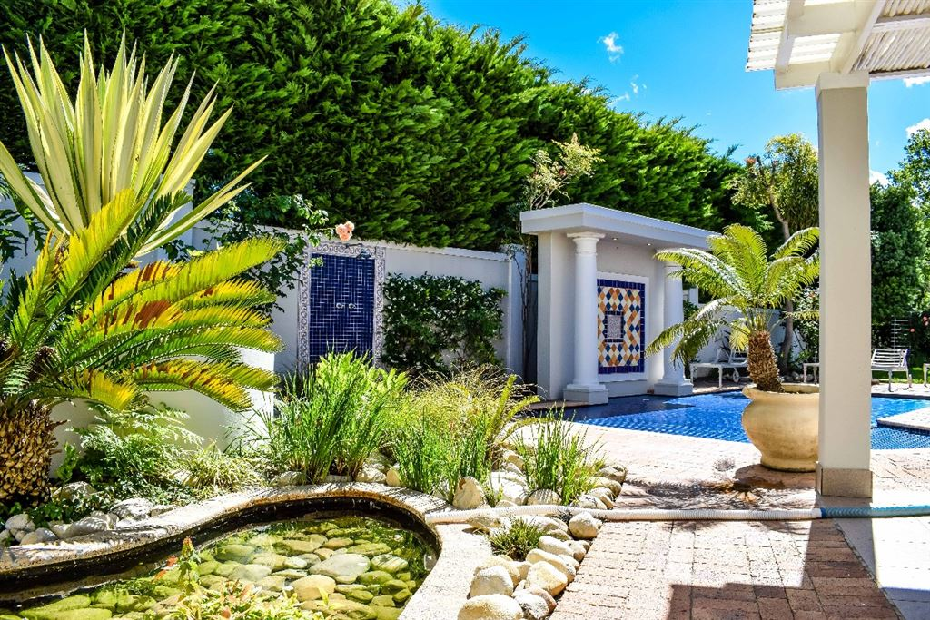Garden with large pool and water feature