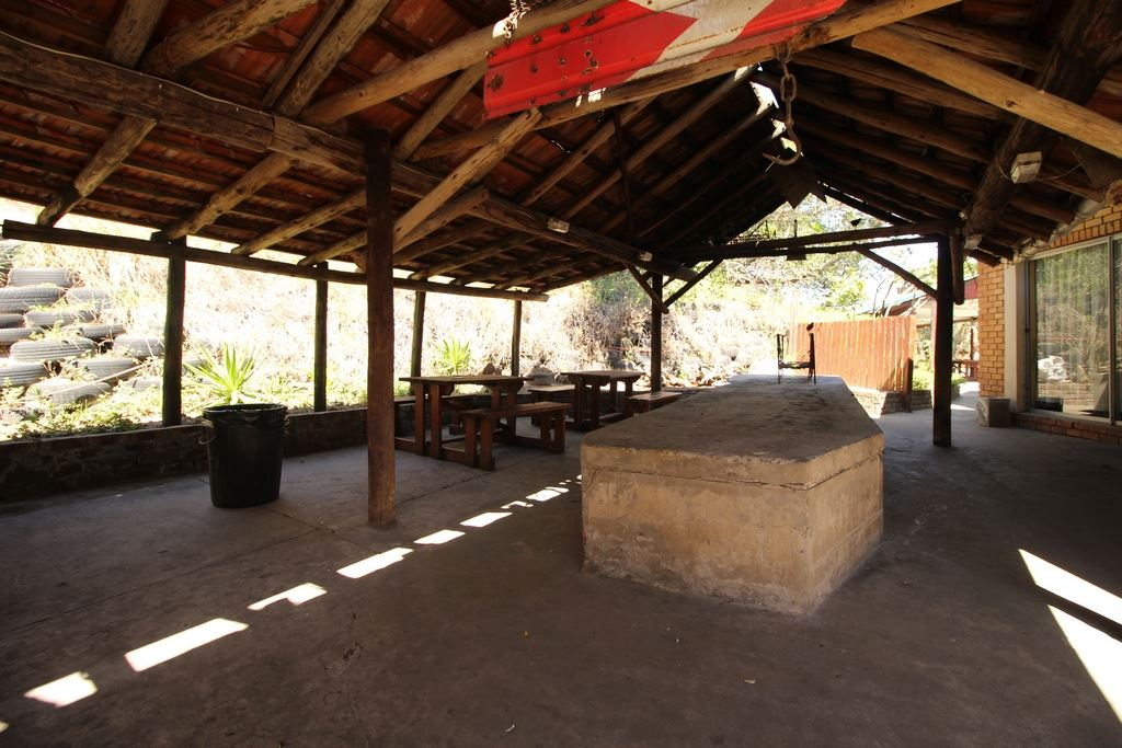 Covered braai area in the courtyard linking the dining hall to the pool area