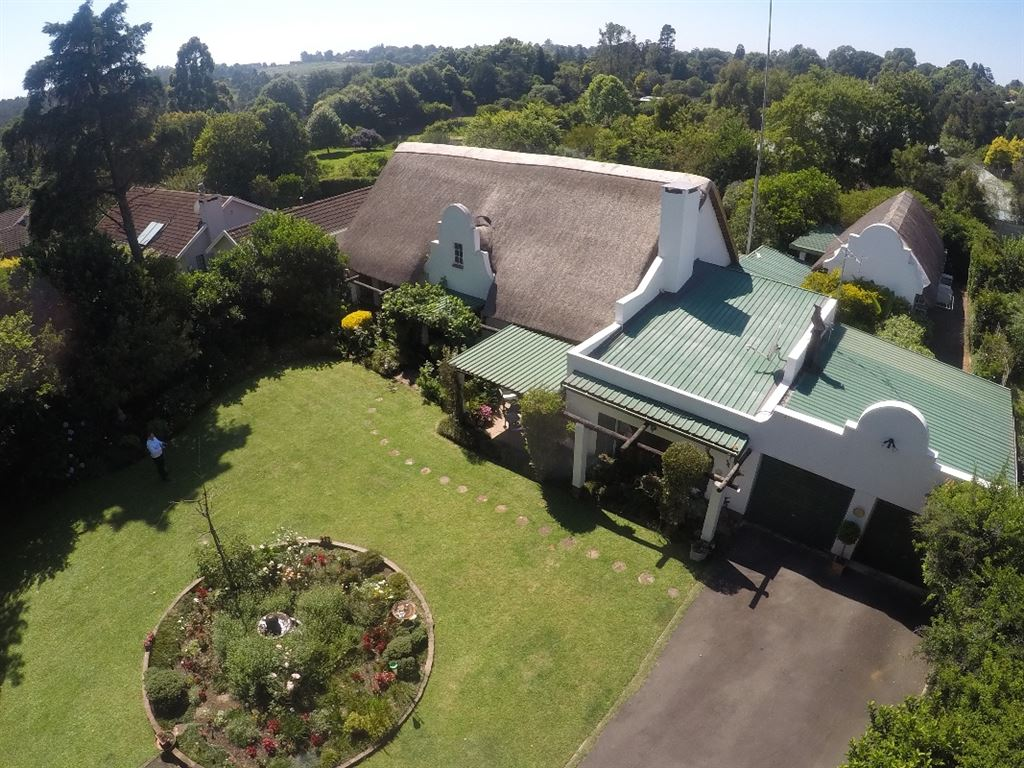 Aerial pic of the front garden and house.