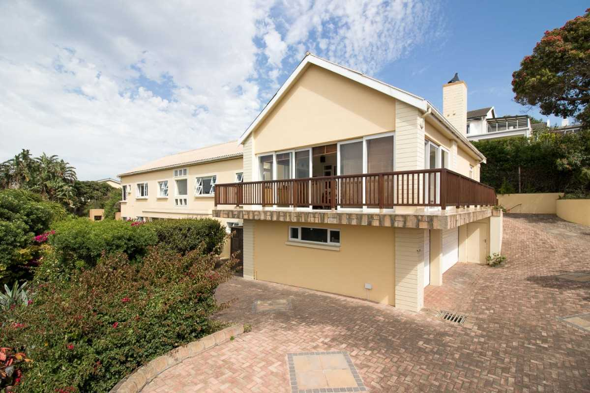Double Storey Family Home with Flat For Sale In Port Alfred, side view of the home and main entrance.