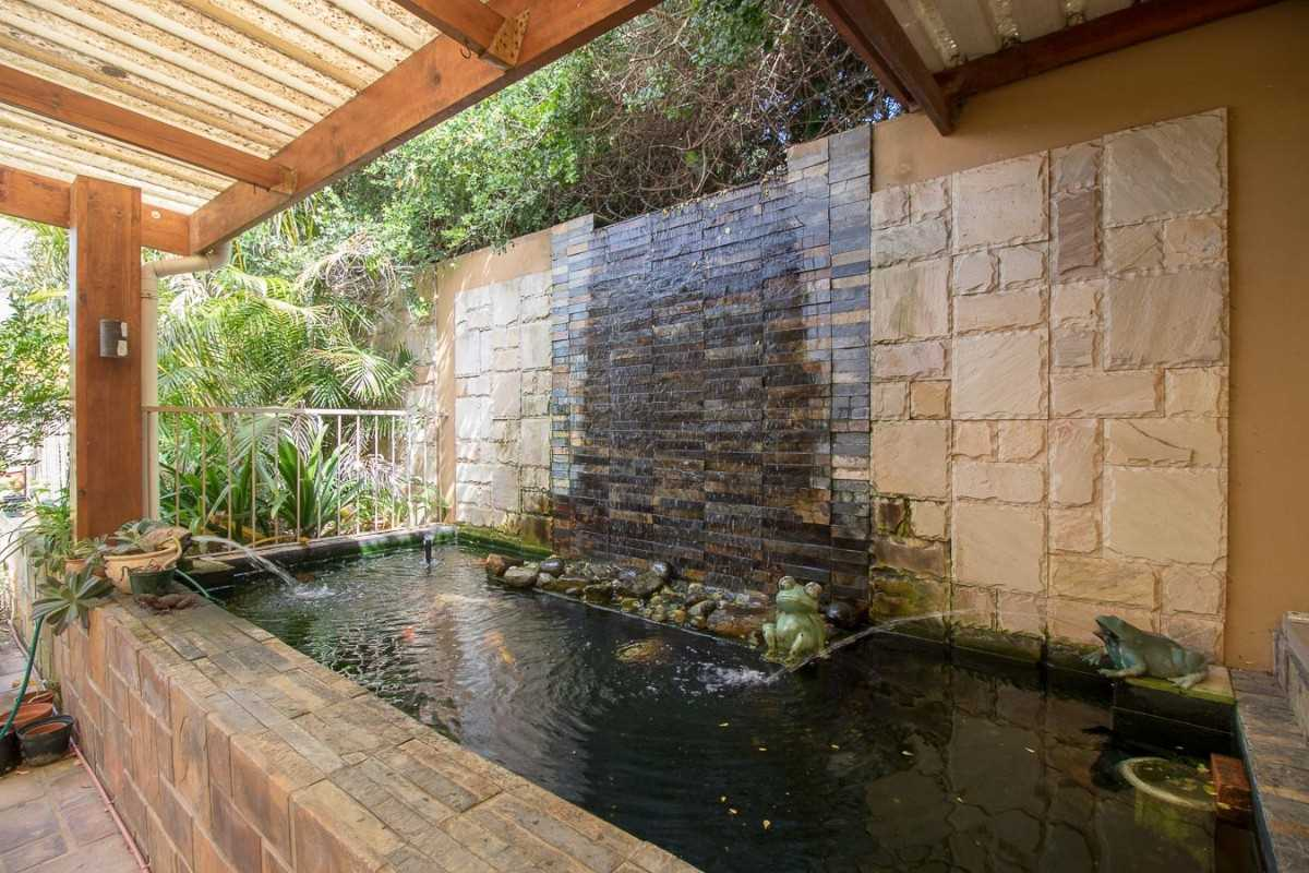 Double Storey Family Home with Flat For Sale In Port Alfred, view of the water fall and koi pond.