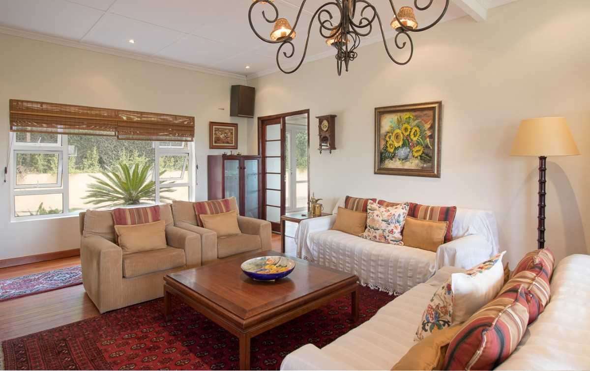 Double Storey Family Home with Flat For Sale In Port Alfred, formal living room with working wood fire place.