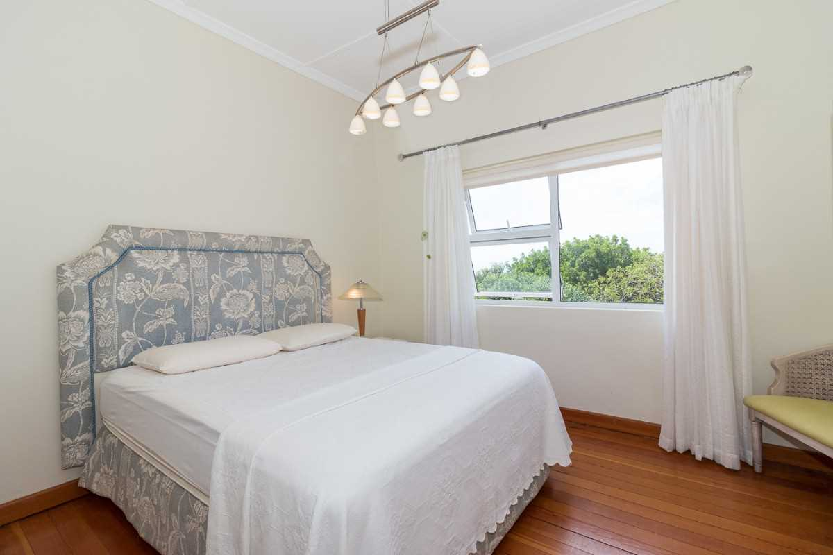 Double Storey Family Home with Flat For Sale In Port Alfred, first bedroom with beautiful wooden floors and with views.