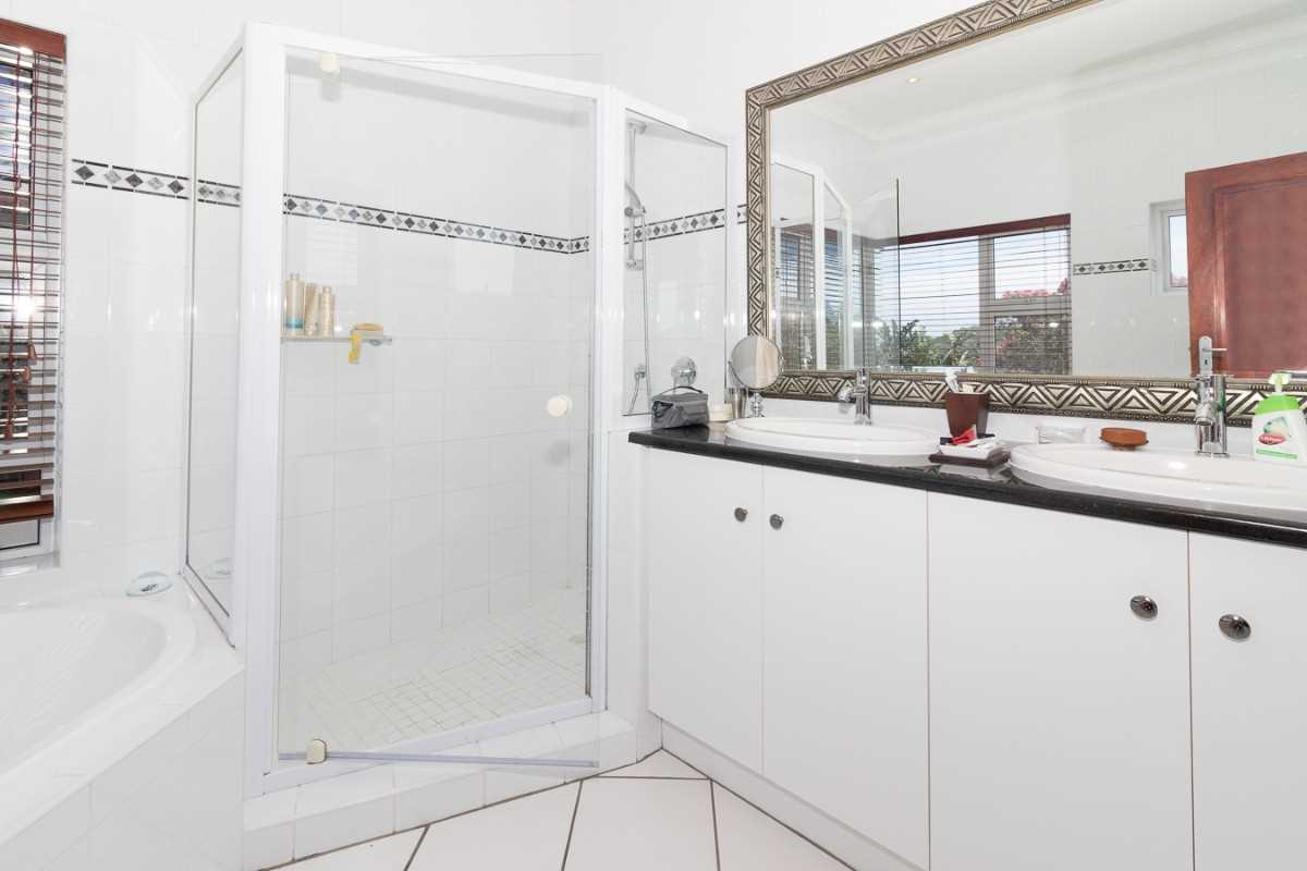 Double Storey Family Home with Flat For Sale In Port Alfred, second view of the main bedroom's en-suite with his and her's wash basins.