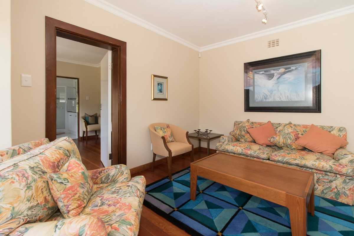 Double Storey Family Home with Flat For Sale In Port Alfred, sitting room on the lower level of the home.