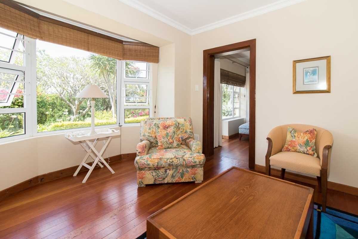 Double Storey Family Home with Flat For Sale In Port Alfred, second view of the sitting room on the lower level.