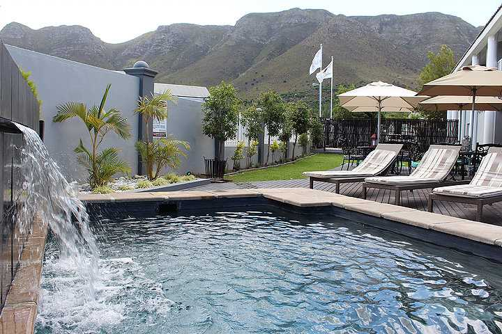 Laze around the pool with the mountain so near you can touch it.