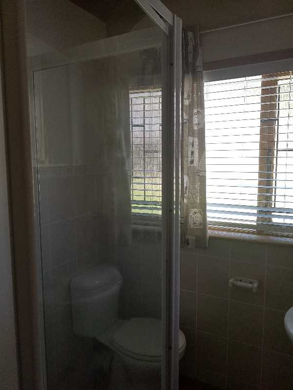 Main bathroom with shower, toilet and basin