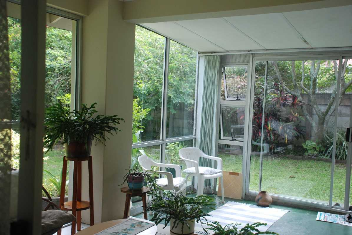 Sunny and spacious porch leading onto peaceful and manicured garden