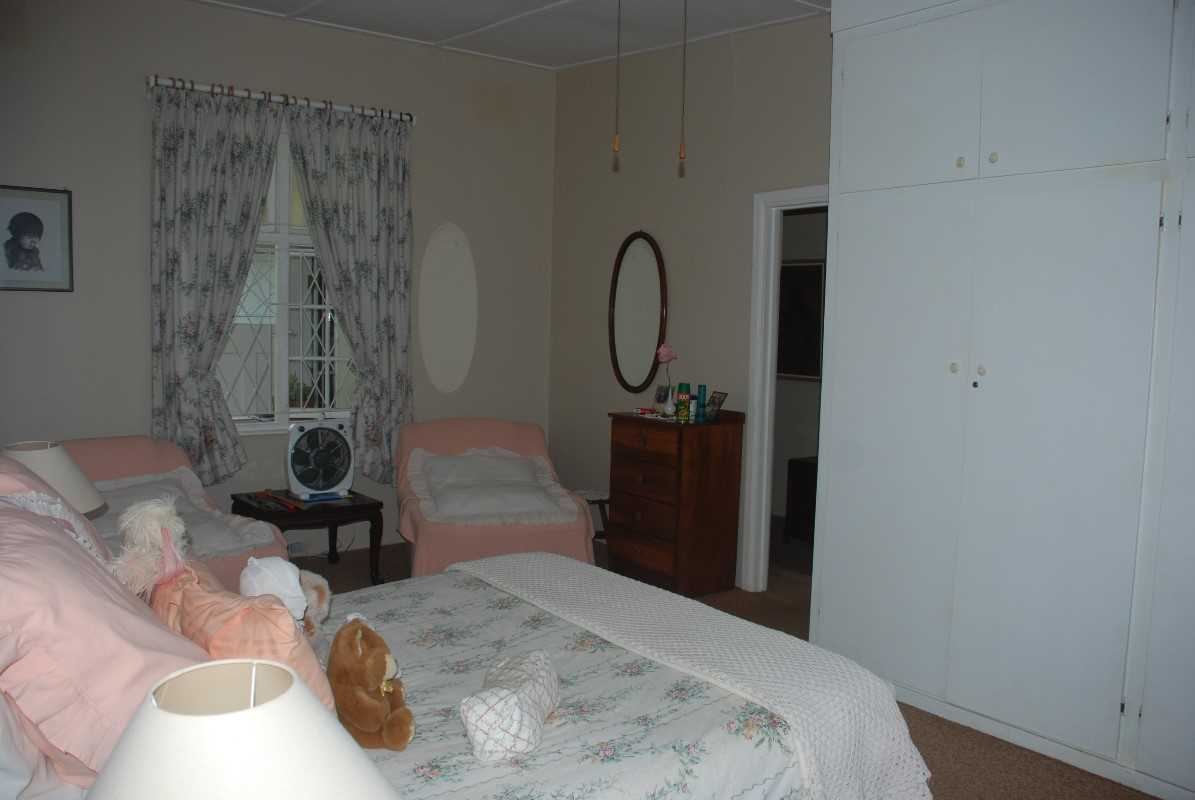 Main bedroom in first house with en suite bath room and dressing area.