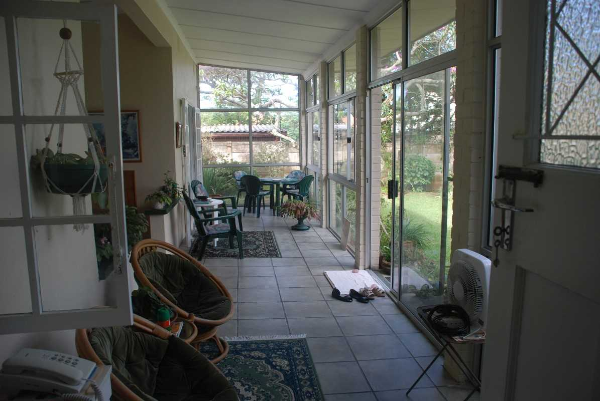 Fully enclosed verandah of first house which leads into lounge, dining room and second bedroom/office