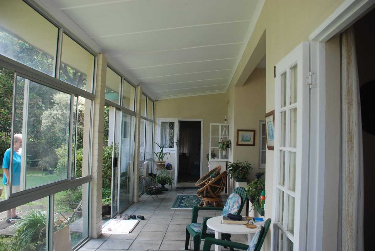 Beautiful totally enclosed verandah of first house. Leads into lounge, office and dining room to provide easy flow for entertainment