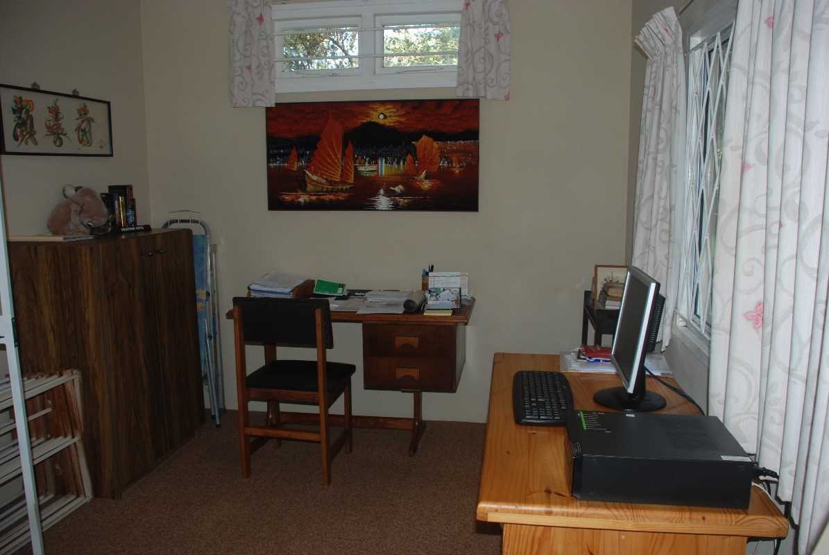 Second Bedroom in First House, currently been used as office.