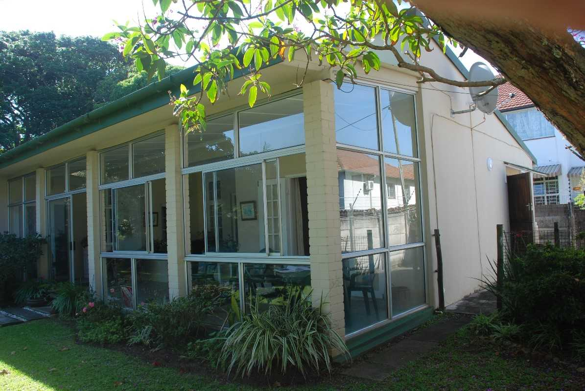 View of enclosed verandah with sliding windows and doors to allow breeze on hot days