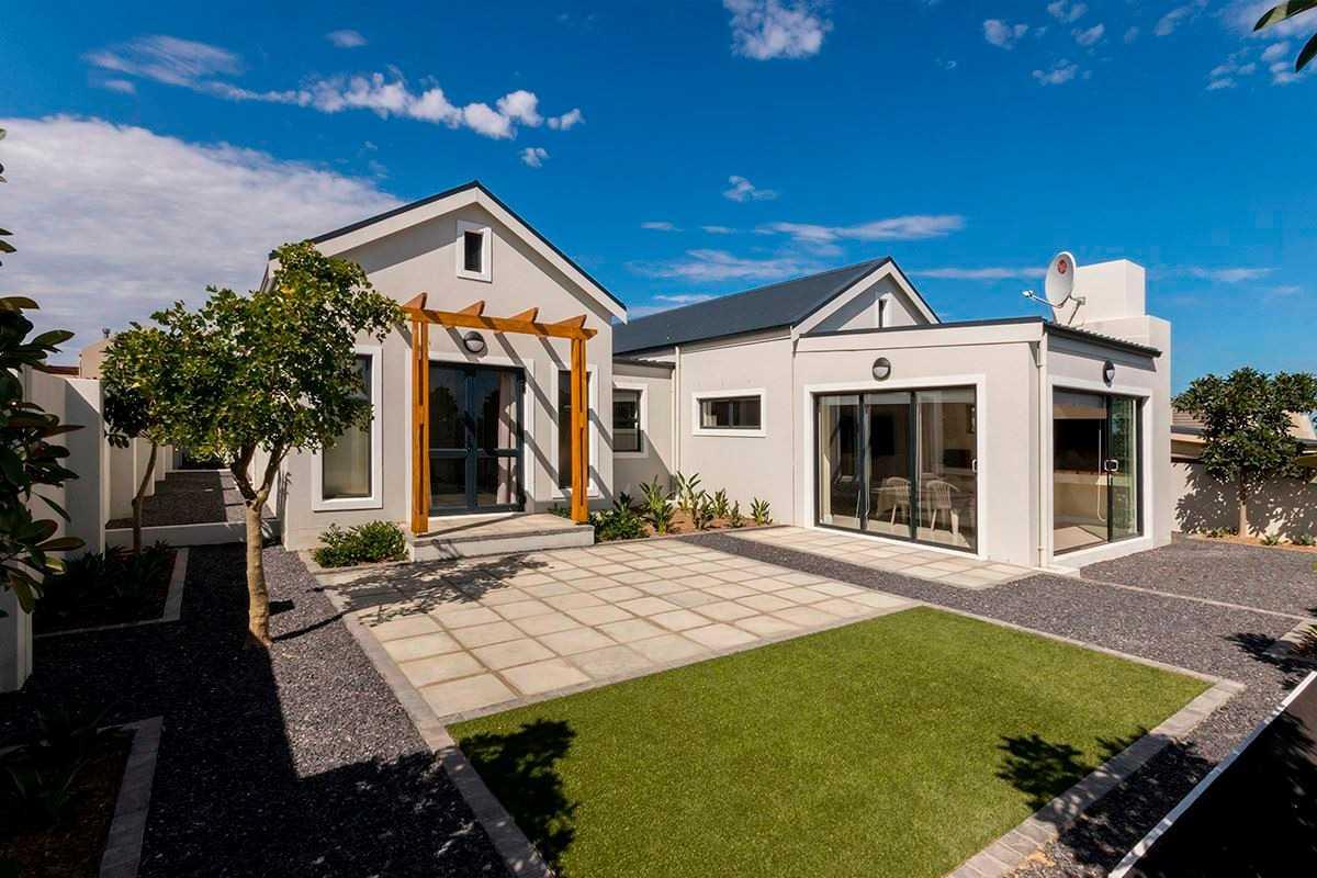 Exquisite Barn Style Home with Designer Garden