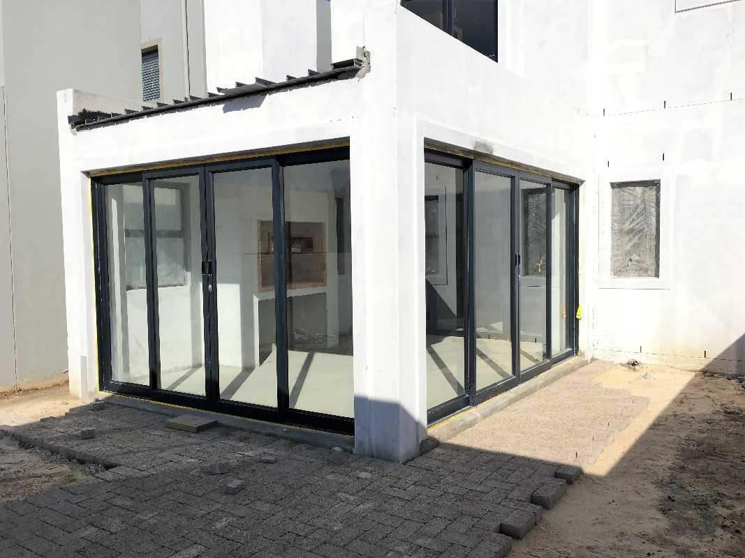 Enclosed patio leading to garden