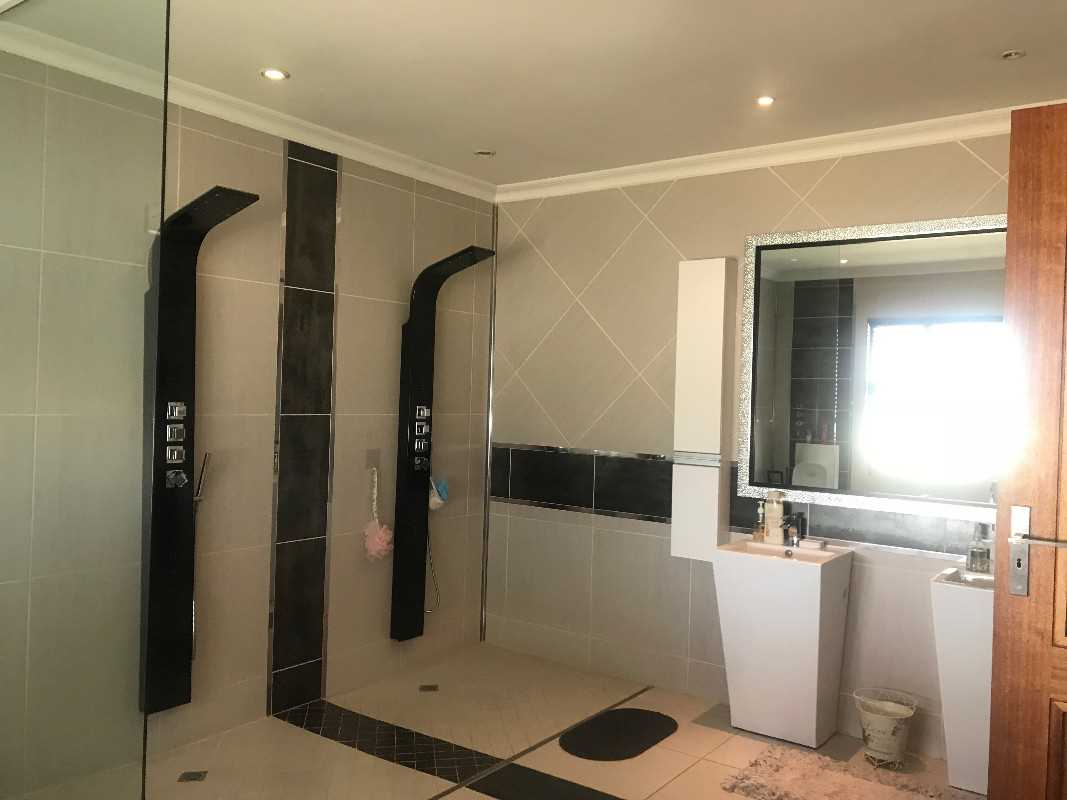 Double shower, double basins and a bath complete the master bedroom bathroom
