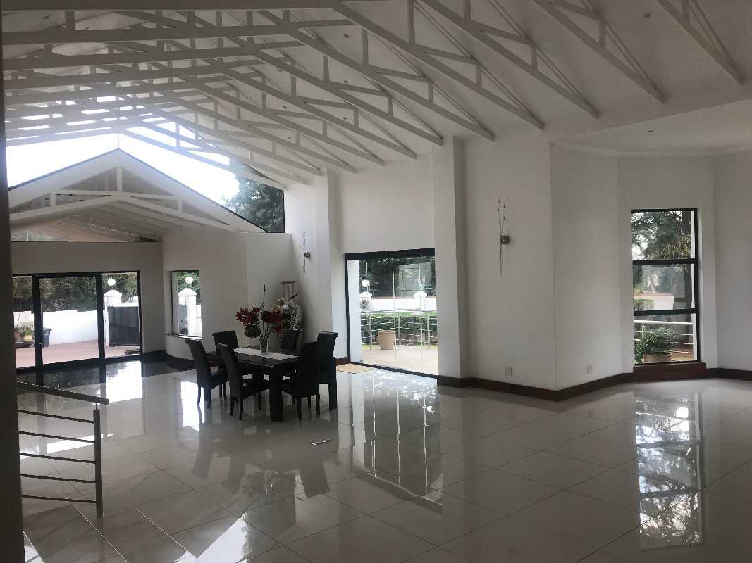 reception area with exposed beams, high ceilings